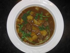 A recipe for Beef & Potato Curry made with beef stew meat, salt, turmeric, vegetable oil, yellow onions, garlic, ginger, cumin