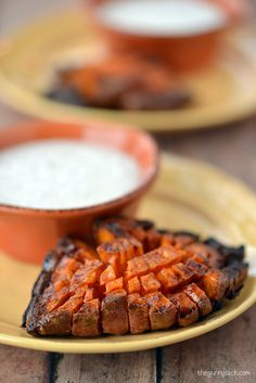 This Blooming Sweet Potato with Marshmallow Cream Dip is a delicious, fun side dish for your holiday dinner! It's another bloomin recipe by The Gunny Sack!