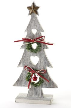 Wooden Tree With Star This is a charming ornament for a homely rustic theme, with love heart cut outs, jolly green wreaths and a jingly red bell, it's the ideal centrepiece for a festive table, whatever its size. Height 22.5cm. www.the-angels-share.co.uk
