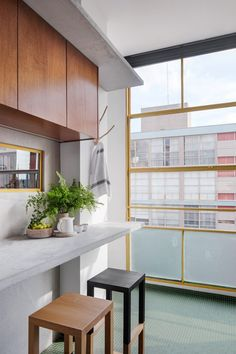 Green tiles in the kitchen match the outer areas of the building. Painted Window Frames, Condominium Interior, New Architecture, Apartment Renovation, Minimal Home, Wardrobe Storage, Open Layout, Parquet Flooring, Lounge Areas