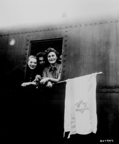 """""""These Jewish children are on their way to Palestine after having been released from the Buchenwald Concentration Camp. The girl on the left is from Poland, the boy in the center from Latvia, and the girl on right from Hungary."""" T4c. J. E. Myers, June 5, 1945."""