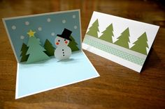 carte-pop-up-Noel-bonhomme-neige-sapins-étoile-jaune