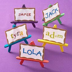Love these, popsicle stick easels~ cute place setting for artsy party