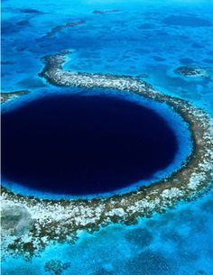 "Blue Hole  It is one of the most astounding dive sites to be found anywhere on earth, right in the center of Lighthouse Reef is a large, almost perfectly circular hole approximately one quarter of a mile (.4 km) across. Inside this hole the water is 480 feet (145 m) deep and it is the depth of water which gives the deep blue color that causes such structures throughout the world to be known as ""blue holes."""