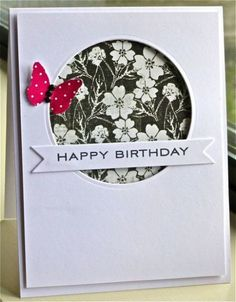 handmade card: Happy Birthday by hskelly ... black and white with a pop of red ... negative space circle window backed with sweet black and white print paper ... fishtail banner for sentiment ... main panel popped up from card surface ... delightful card!!