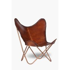 Add a touch of class to your home with this butterfly leather chair. The leather seat is supported by a tubula, copper frame. Leather No assembly required.