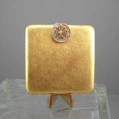 Avon Powder Compact Vintage Woman's Make-up Accessory Goldtone with Rhinestone Clasp. 14.00, via Etsy.