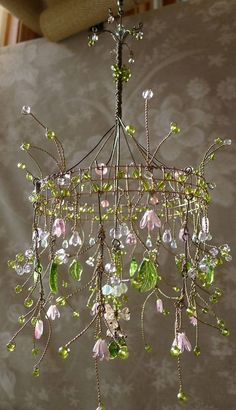 Delicate wired chandelier that appears to be more decorative than functional