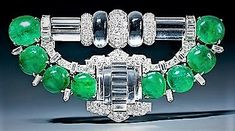 """Lara Maynard l'a enregistrée dans """" Vintage / Antique Jewelry Group Board """" A magnificent Art Deco rock crystal, emerald and diamond clip brooch, set with 8 cabochon emeralds, carved rock crystal and baguette cut, old European cut and single cut diamonds, mounted in platinum and 18 karat gold. Circa 1937-38, unsigned, accompanied by the Mauboussin certificate of authenticity, stating that this brooch was made by Trabert & Hoeffer - Mauboussin between 1937 and 1938.. mm"""