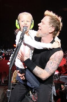 James Hetfield on stage with daughter