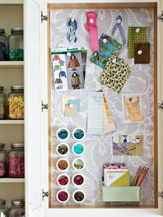 """""""It's a Stickup: A bank of 7-inch-deep cabinets allowed for creative storage ideas such as this magnetic memo board. A piece of galvanized metal was cut to fit then screwed to secure it to the cabinet back. For a pretty finish, it was covered with wallpaper."""""""