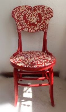 I think I just found my next DIY remodel project! Love gold pattern against the red.