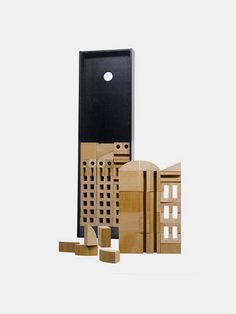 """Bruno Munari's MC 1 Architecture Box was first designed and produced in 1945 and comprises a series of different shaped """"bricks"""" that can be combined to make an amazing variety of buildings and architectural structures. A wonderful play set for your imagination. Sixty six wooden blocks Presentation box Mini book with over sixty architectural examples to build Pear wood Made in Italy Box 17.7 x 5.1 inch"""