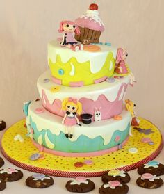 This is a birthday cake for  my little daughter - with her favorite toys - all dolls are made from sugarpaste
