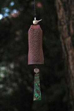 Red clay, vines design EarthWind Stoneware ceramic garden bell.