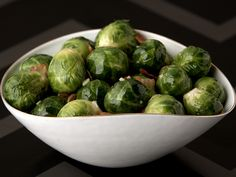 Brussels Sprouts With Pancetta  Giada infuses Brussels sprouts with the flavors of pancetta, garlic cloves and chicken broth in a large skillet.  SHARE THIS GALLERY:  Share to Facebook Share to Twitter Embed Link