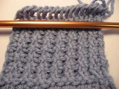 Here is another variation of Tunisian Crochet which I think is very pretty. It's called Tunisian Crossed Stitch and when you see the sample...