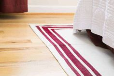 Learn how to make a rug from a simple canvas drop cloth! This DIY rug is soooo easy and only needs fabric paint and painter's tape for a clean, modern look! Drop Cloth Rug, Canvas Drop Cloths, Floor Cloth, Drop Cloth Projects, Farmhouse Fabric, Farmhouse Style, Painted Rug, Interior Rugs, Fabric Rug