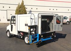 HTS-20S-TD Swing Mount Ultra-Rack installed on Taylor-Dunn ET-150-74 Electruck by TMH Toyota Material Handling of Northern California for Chevron Energy.