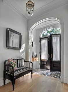Our Urban Smokebell and Garrison illuminate the gorgeous arched vestibule of this recently renovated 1886 Chicago residence. Urban Smokebell shown in bronze; Garrison shown in heirloom with partially etched glass. Home Interior, Interior And Exterior, Interior Design, Brownstone Interiors, Townhouse, Estilo Colonial, Flur Design, Hallway Designs, Entry Foyer