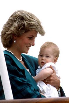 Princess Diana holding Prince Harry, 8 months, on a cruise in Italy in 1985.