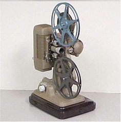 8 MM projector...this is how we viewed instructional movies in school (flipflipflip)