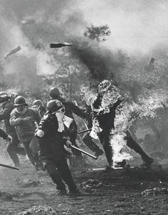 1978 - A demonstrator is engulfed in flames of the molotov cocktail he was about to throw at the police during protests against the construction of the New Tokyo International Airport. The original Narita Airport plan was unveiled in 1966. To acquire the initial land, the government had to evict protesting landowners. Violent clashes between the opponents and authorities resulted in 13 deaths, including five police officers. The new airport opened in May 1978. (Sadayuki Mikami)