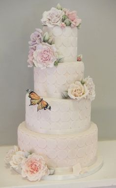 4 Tier Vintage wedding cake with gumpaste flowers roses and hand-painted butterfly