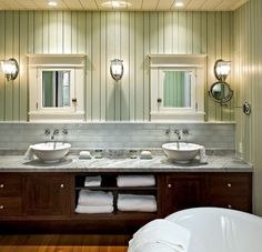101 BEACH BATHROOMS! Discover beautiful beach themed bathroom designs for your home. All designers and photographers are given credit in the article.