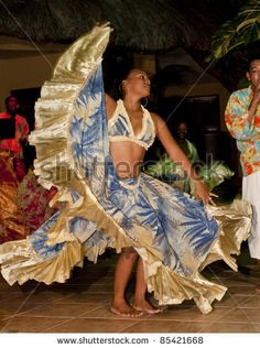 LE MORNE, MAURITIUS - MAY 11: Performers dressed in a traditional mauritian costume performs a sega dance at the Le Paradis Hotel in Mauritius on May 11, 2011. by bengy, via ShutterStock