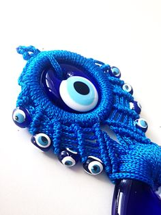 A personal favourite from my Etsy shop https://www.etsy.com/listing/278475924/blue-macrame-wall-hanging-evil-eye-wall