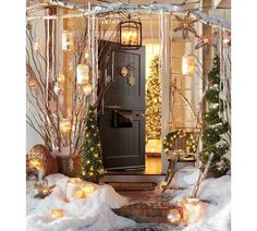 Pottery Barn porch - a bit too much and stagey but I do like the birch branches over the doorway and the twig stars hanging from them.