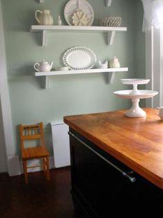 teal wall....white shelves....cute decor...