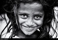 Happy young poor lower caste Indian street girl smiling. Monochrome © Tim Gainey / Alamy