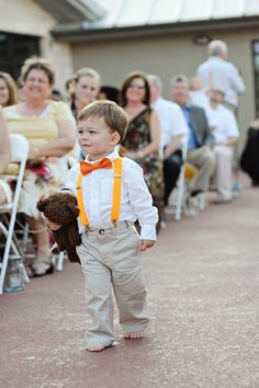 instead of a rented tux the ring bearer can wear the wedding colors as suspenders and a bow tie