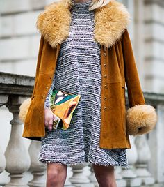 Street Style  A metallic clutch adds contemporary appeal to a retro suede coat and knit turtleneck dress.