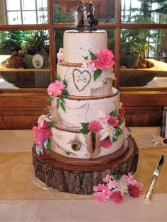 Birch Bark Wedding Cake for a couple with Norwegian ancestry.  Sugar flowers including edelweiss.