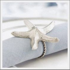 These elegant silver starfish napkin holders add beauty to any table. They also look great in the bathroom with wash clothes. Coastal Colors, Coastal Style, Coastal Living, Coastal Decor, Ocean Home Decor, Beach Cottage Decor, Cottages By The Sea, Beach Cottages, Beach Picnic