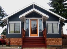 This link shows such an amazing transformation. I love the new look of the house- dark homes with contrasting pops of whites have a special place in my heart. Lastly, such a great idea to put cedar shingles to cover old foundation!