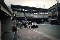 Concrete expressway ramp collapse after the 7.3 magnitude Great Hanshin Earthquake near Rokkōmichi Station, Nada, Kōbe, Hyōgo Prefecture, Honshū, Japan, 1995, photograph by Hayato Oura.