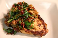 Sauteed Caramelized Onions, Sun-Dried Tomato, Garlic & Baby Spinach over Grilled Chicken