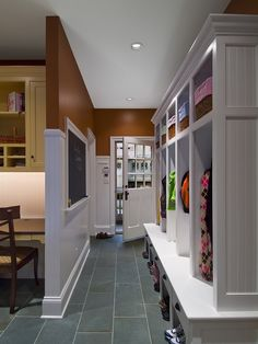 mudroom:  what isn't so obvious is the desk space right there in the mudroom;  every house with kids needs some sort of command central that is IN the mail pathway but not in plain sight of the rest of the house.