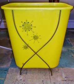 Cute kitschy mid-century Rubbermaid wastebasket with metal frame, $14. (SOLD)