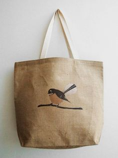Fantail on a burlap tote bag