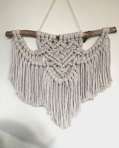 This macrame wall hanging is hand-to-order by Han in Sydney, Australia. It is made with 100% natural cotton with natural wood. This piece would go perfectly in a cluster with other artworks to fill a wall space in the living room, bedroom, bathroom or kitchen. Please note stick will look slightly different to the image.  Please allow 2 weeks for your wall hanging to be completed.  Measurements: Length 40cm (stick end to end) Height 34cm
