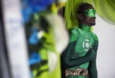 The dead body of Renato Garcia, dressed in a costume of comic book character Green Lantern, is seen at a house in San Juan, Puerto Rico February 16, 2015. Garcia was a fan of the Green Lantern and his family decided to set up a little shrine with his remains dressed up in honor of his passion for the superhero character. REUTERS/Alvin Baez-Hernandez