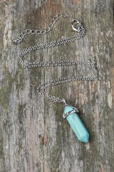 This simple pendant necklace with a bullet turquoise stone is a cute way to add a little something to your summer outfit.