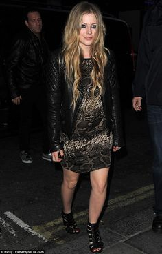 Bad wind: A sudden gust has been blamed on Avril Lavigne looking pregnant in London on Wednesday