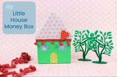 DIY Little House Money Box , in shabby chci style. A perfect craft for kids with scrapbooking papers and beautiful pom pom!