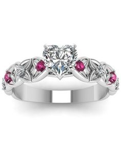Heart Shaped Diamond Side Stone Ring With Pink Sapphire In 950 Platinum